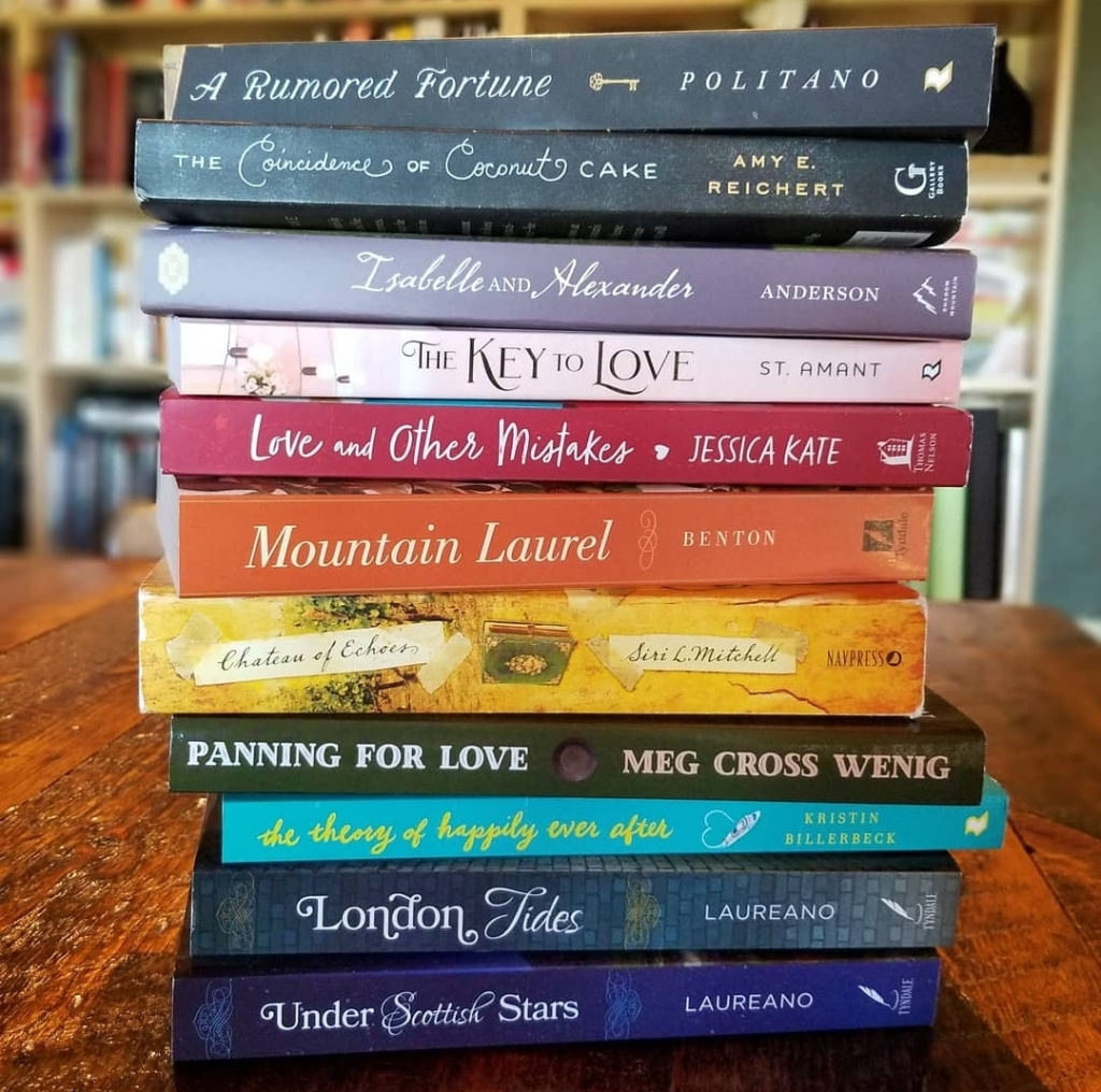 stack of 11 books with a rainbow of spines